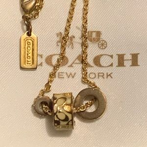 Coach gold necklace